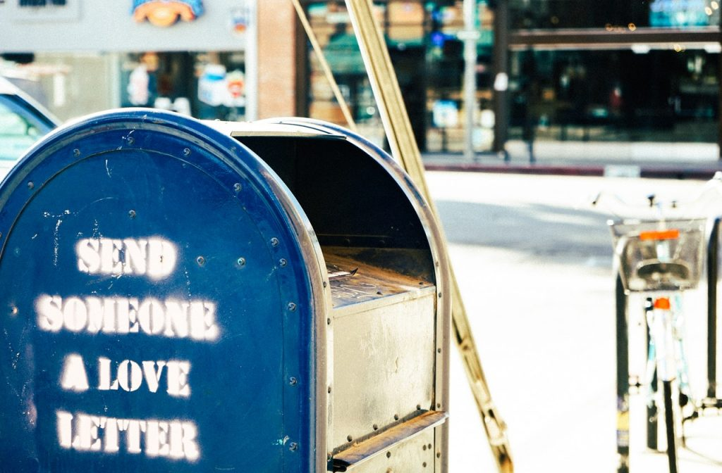 blue post box with Send Someone a love letter in white print