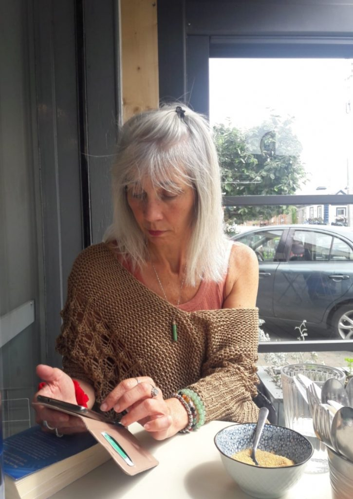 Silver hair lady on her phone